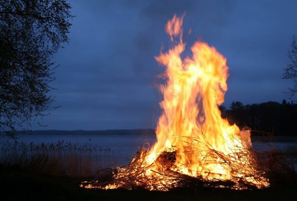 bonfire by lake at night
